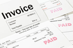 Invoice with Paid Stamp - three invoices with paid stamped on them. All details are imaginary.